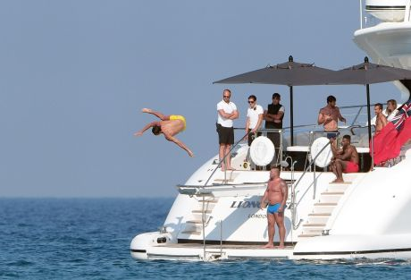 Cristiano Ronaldo shows off with a spectacular jump on the sea from a luxury yacht in Saint Tropez