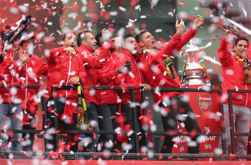 Olivier Giroud celebrates during the parade