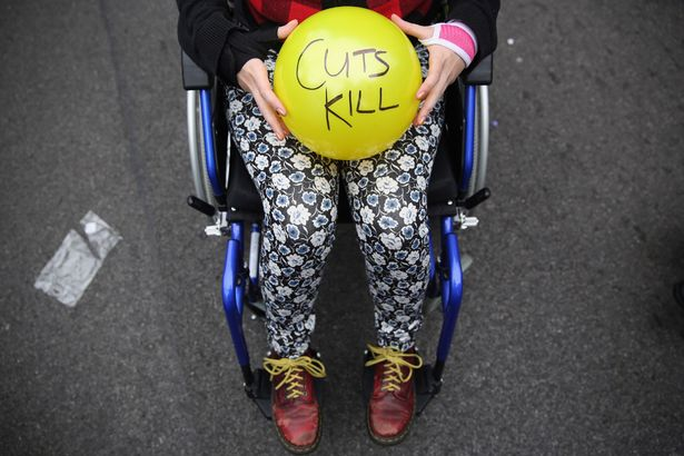 Anti austerity protesters prepare to throw balls towards Downing Street after the Chancellor of the Exchequer George Osborne left 11 Downing Street on July 8, 2015 in London, England.