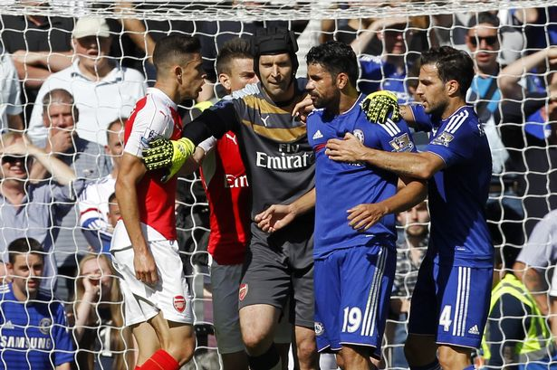 Gabriel and Diego Costa are separated by Petr Cech as they clash