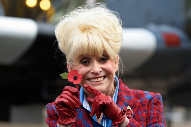 Barbara Windsor poses with a poppy at the launch of the British Royal Legion's London Poppy Day