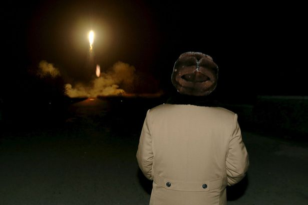 North Korean leader Kim Jong Un watches the ballistic rocket launch drill