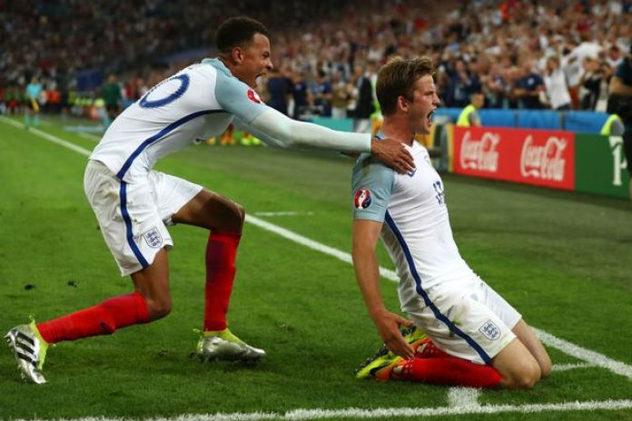 Eric Dier celebrates scoring the first goal with Dele Alli