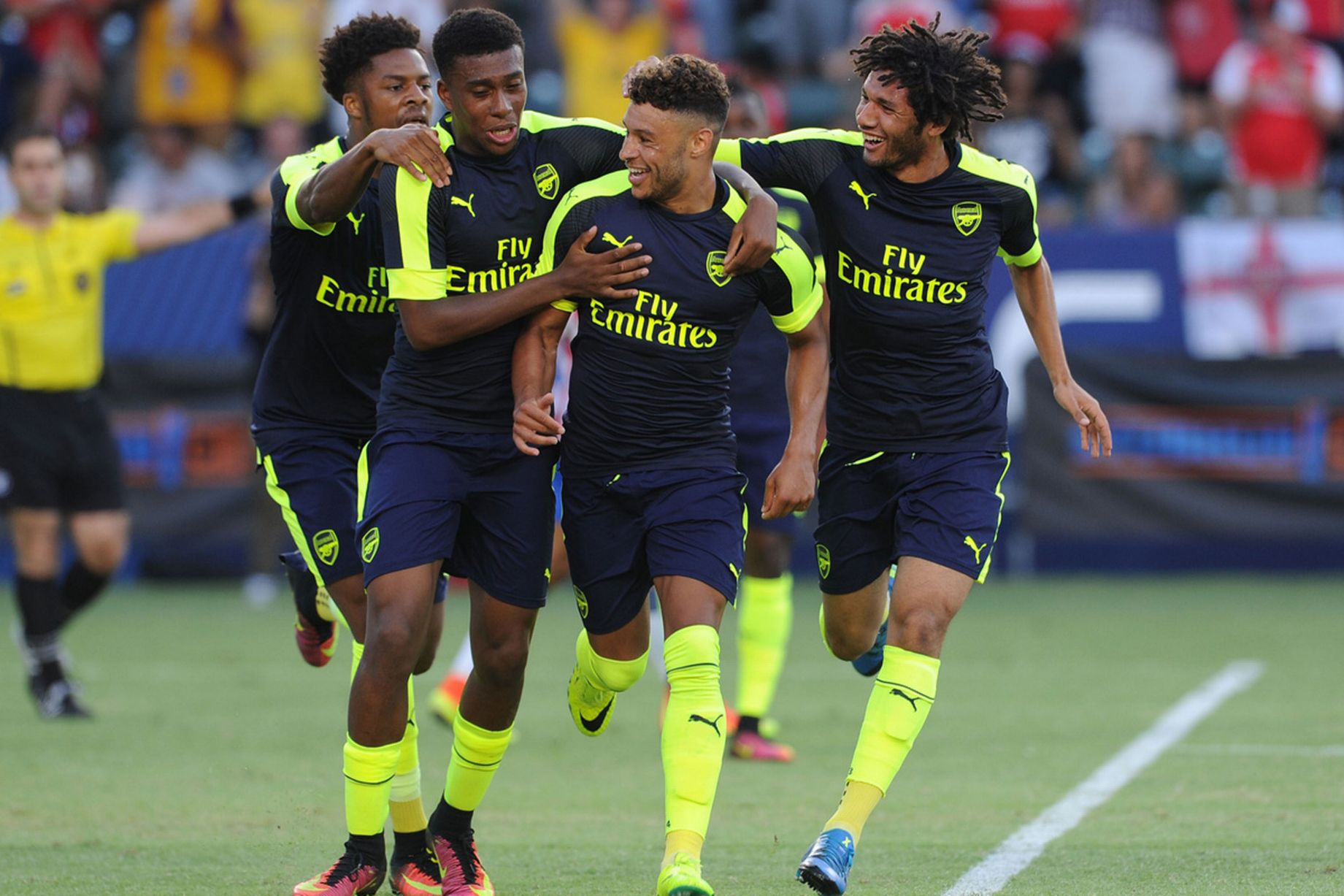 Alex Oxlade-Chamberlain celebrates scoring Arsenal's second goal with Chuba Akpom, Alex Iwobi and Mohamed Elneny
