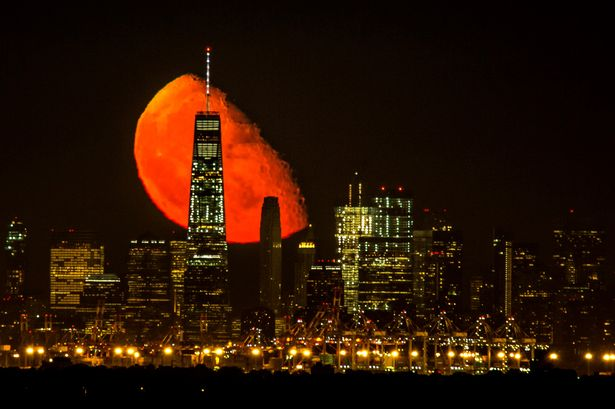An incredible moon rise behind the World Trade Center, Manhattan