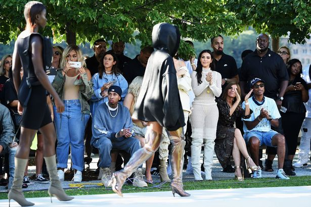 Tyga, Kylie Jenner, Kendall Jenner, Kim Kardashian, Carine Roitfeld and Pharrell Williams attend the Kanye West Yeezy Season 4 fashion show