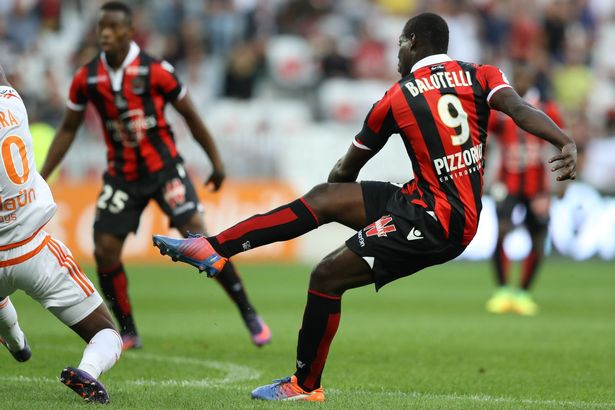 Mario Balotelli shoots to score a goal