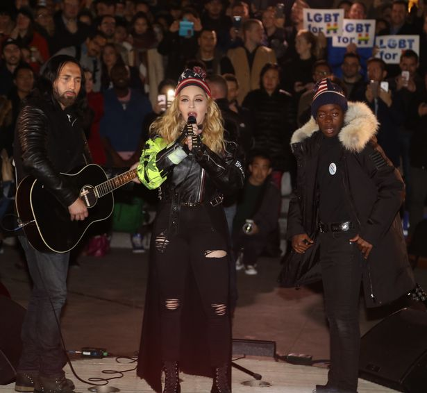 Madonna and her son David Banda made a surprise concert in at Washington Square Park in New York City, NY, USA.