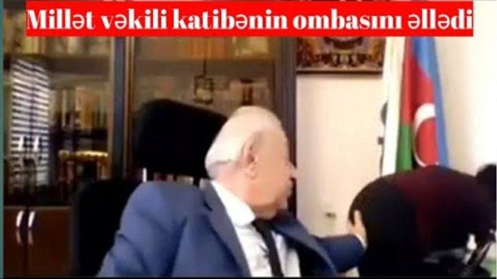 Deputat Huseynbala Mirelemov katibenin ombasini elleyerken canlı yayima düşdü