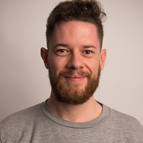 Liam Geraghty smiling and with a beard, one of the LGBT+ broadcasters to check out on World Radio Day