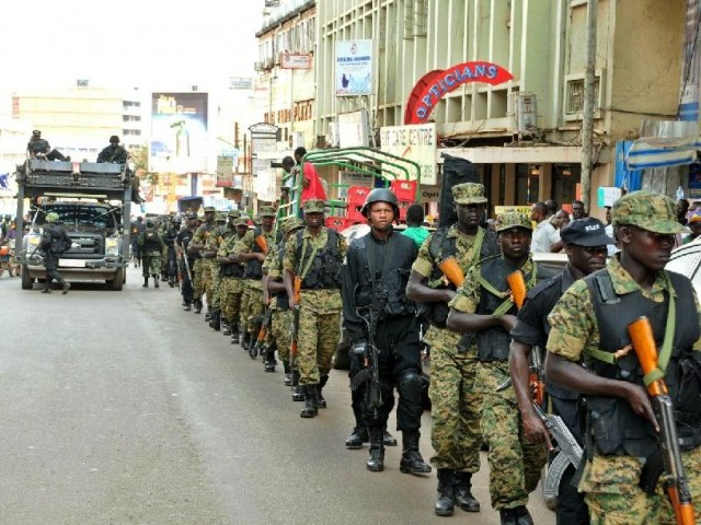 Ugandan soldiers and police forces patrol streets in Kampala on July 3 2014.