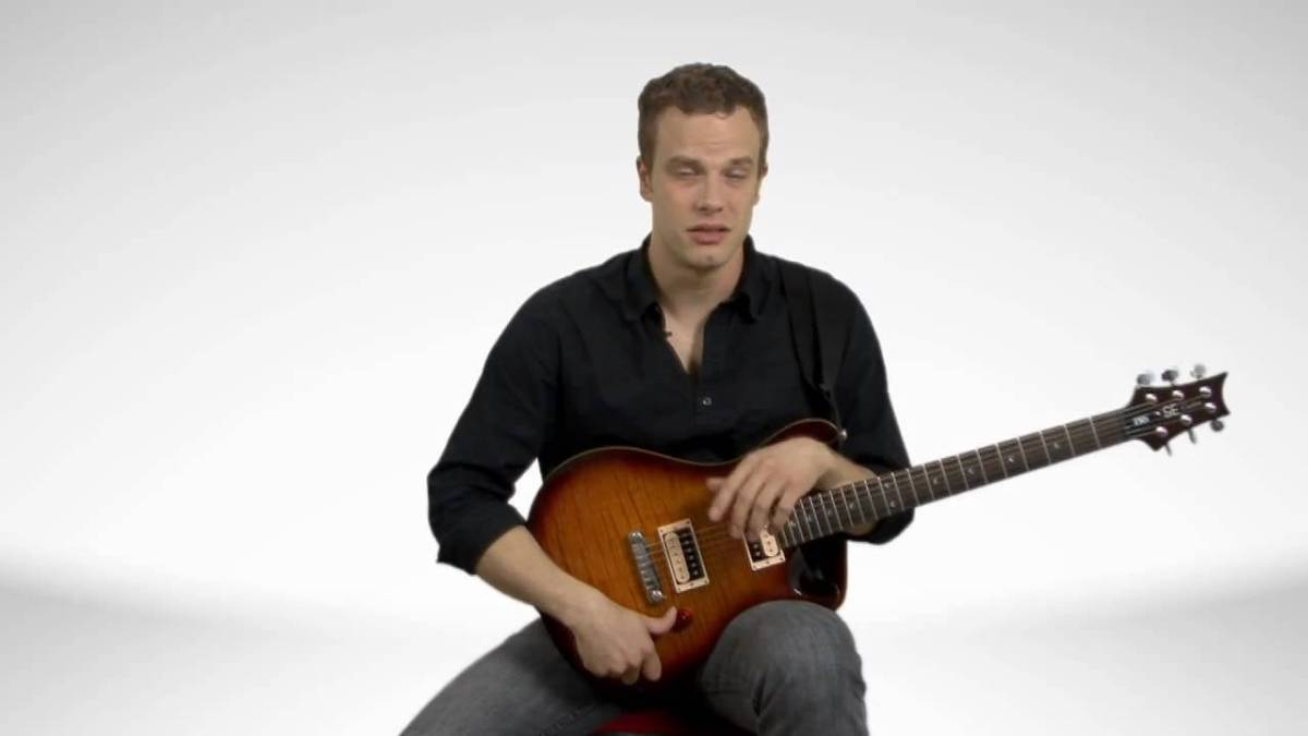 How To Hold An Electric Guitar - Guitar Lessons - YouTube