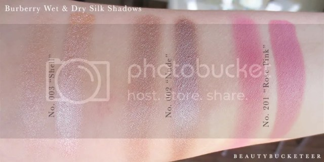 "Burberry Beauty Wet & Dry Silk Shadows No. 003 ""Shell"", No. 002 ""Nude"" and No. 201 ""Rose Pink""."