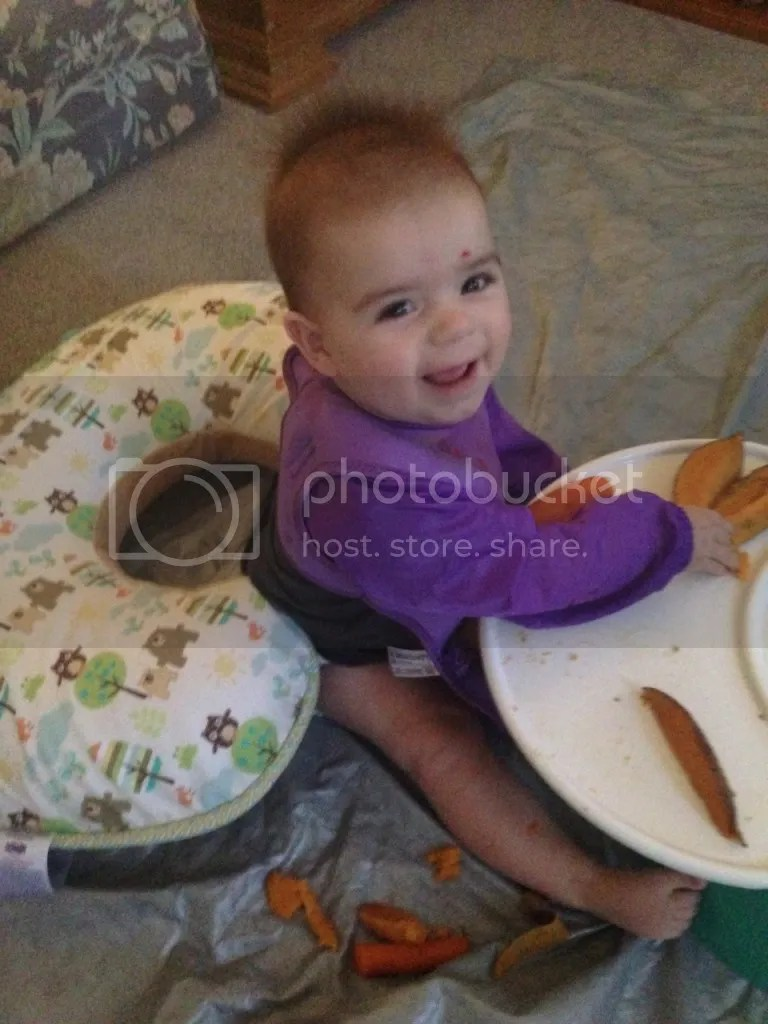 My sweet baby enjoying the BLW process with her roasted sweet potatoes.