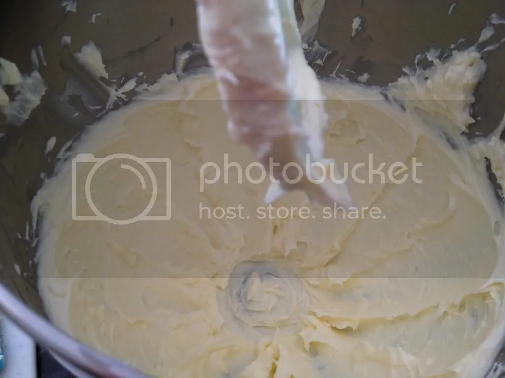 Cream together butter and cream cheese to make cream cheese frosting in an electric mixer.
