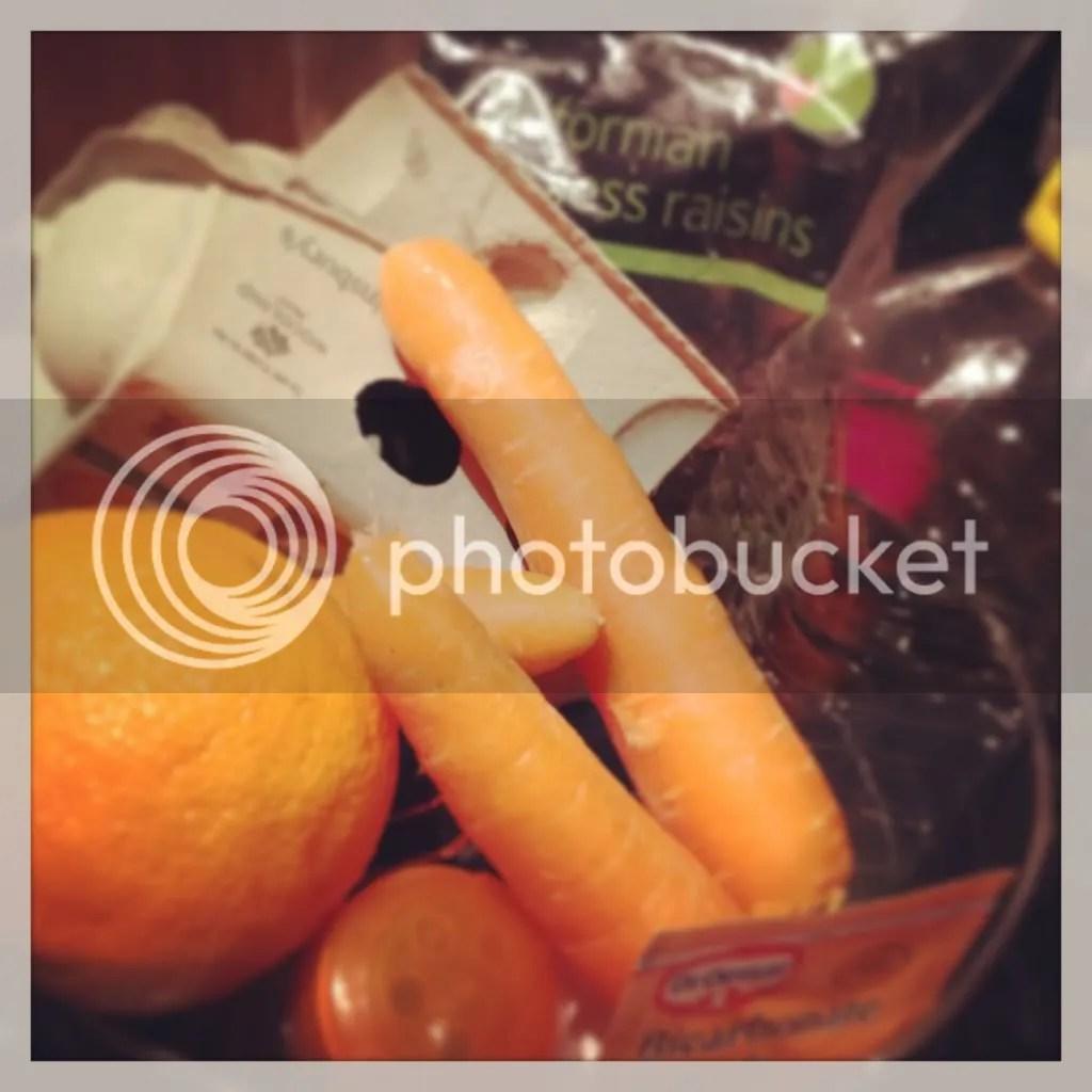 Carrot Cake Ingredients - Carrots, eggs, raisins, vegetable oil, orange, flour