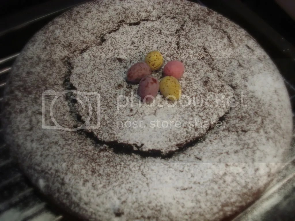 Dust with icing sugar and top with season treats such as chocolate covered easter eggs.