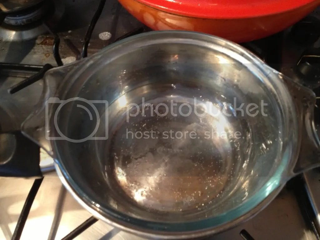 A bain marie made with a heat proof bowl and a sauce pot with a bit of water.