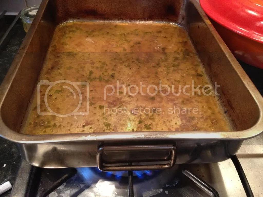 Place your roasting dish with all the drippings on the stovetop over a medium heat.