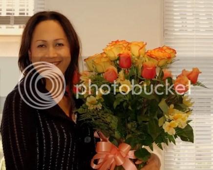 Sa beside her birthday bouquet.