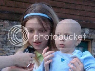 Rachel & Benjamin observing a chick