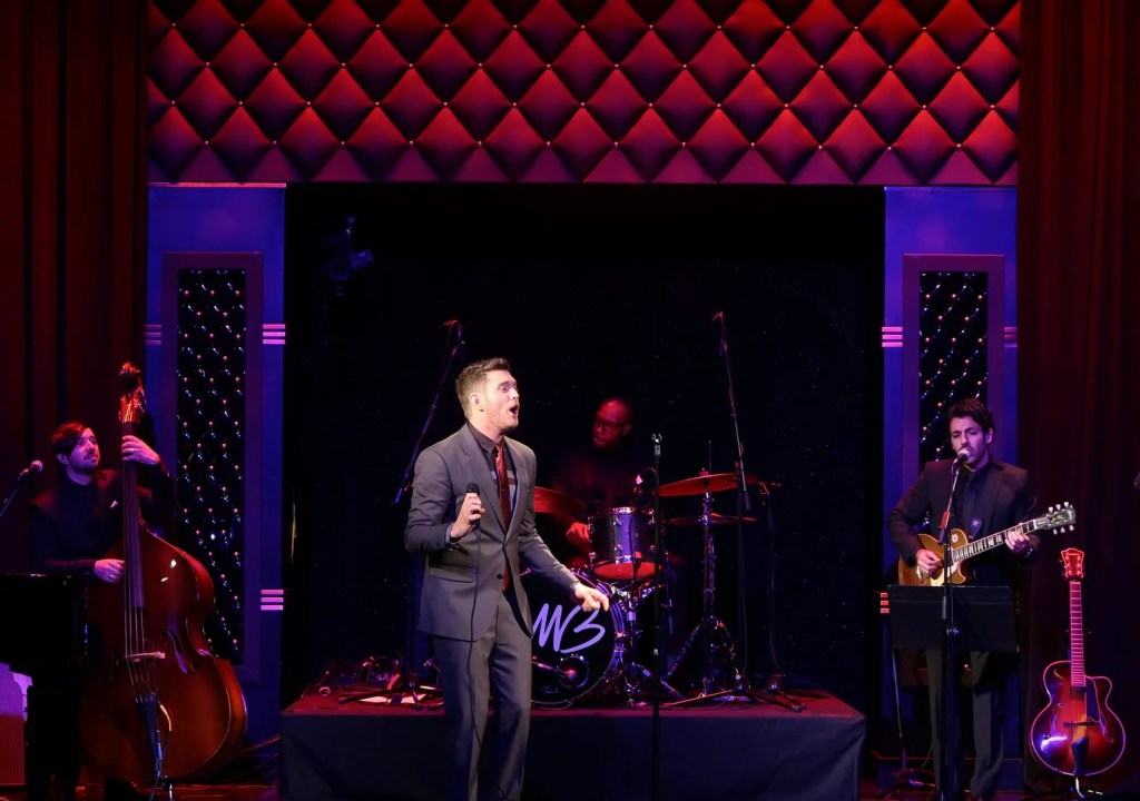 Michael Buble performing at By Invitation perfume launch
