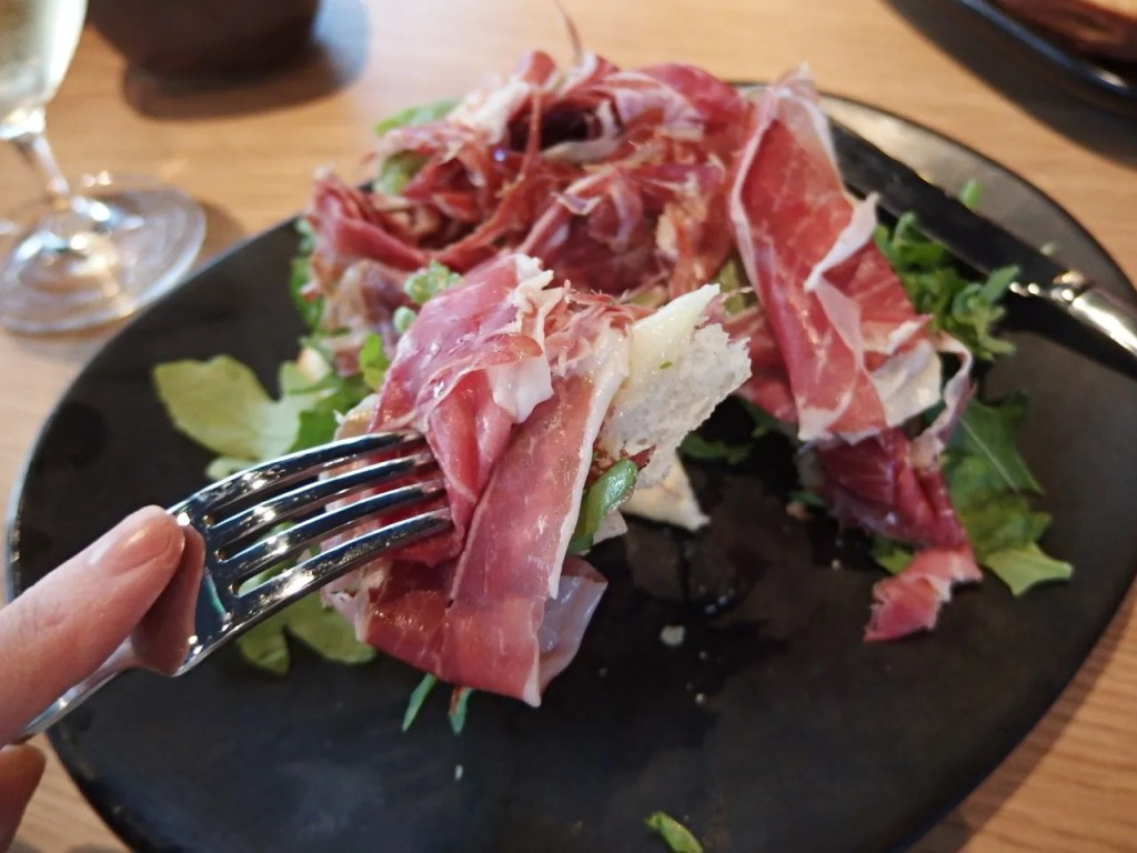Iberian jamon, mozzarella, rocket on cocoa bread
