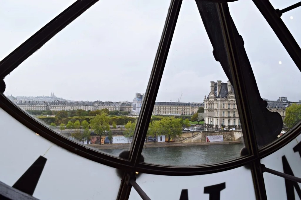 Musee D'Orsay clock view on the seine