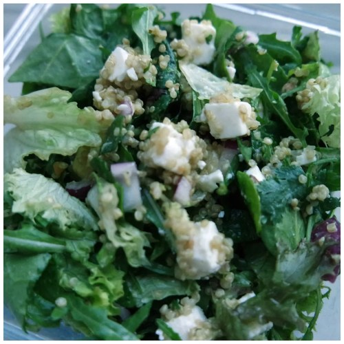 Quinoa salad with feta cheese, red onion and leafy greens