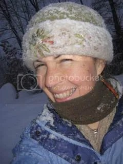 Knitted-felt hat artist, Carrie Cahill Mulligan attempts a snowy self-portrait photo to show Melissa Lanitis Gregory's lightweight & cheerful recycled paper (therefore not cold against the skin!) earrings, New Boston, New Hampshire, New Year's Day, 2008.