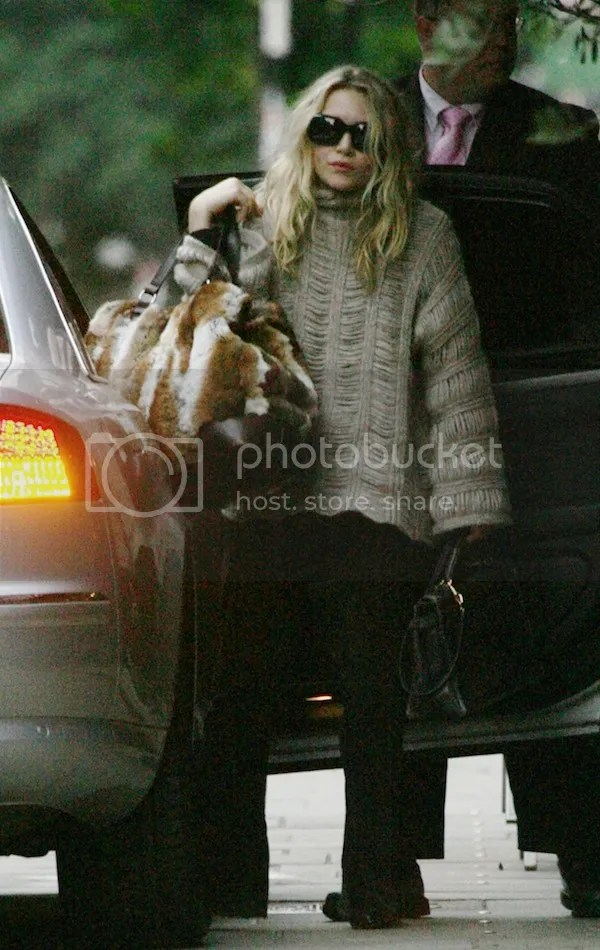 OLSENS ANONYMOUS MARY KATE OLSEN OVERSIZED TEXTURED KNIT SWEATER WITH BELL SLEEVES BIG FUR BAG HERMES KELLY BAG BLACK CORDUROY PANTS BOOTS SUNGLASSES LONDON 2009 photo OLSENSANONYMOUSMARYKATEOLSENTEXTUREDKNITFURBAGLONDON2009.jpeg