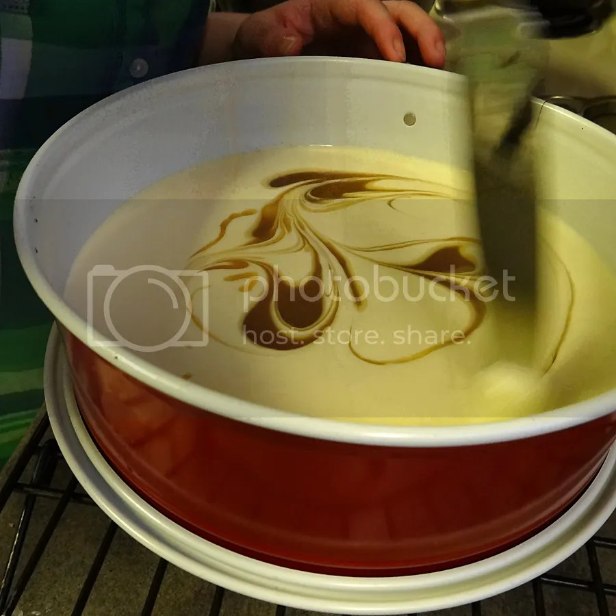 swirl caramel sauce in cheesecake mixture