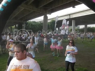 Marisa and I (the two in the rainbow socks) crossing the finish line of The Color Run - Louisville, Kentucky