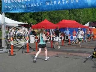 Me crossing the finish line of the Minneapolis Half Marathon – Minneapolis, Minnesota