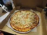 Pizza Ranch Gluten-Free Pizza with mozzarella cheese, tomatoes, onion, and mushrooms