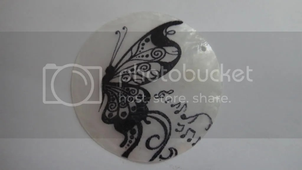 black butterfly painting on round flat bead
