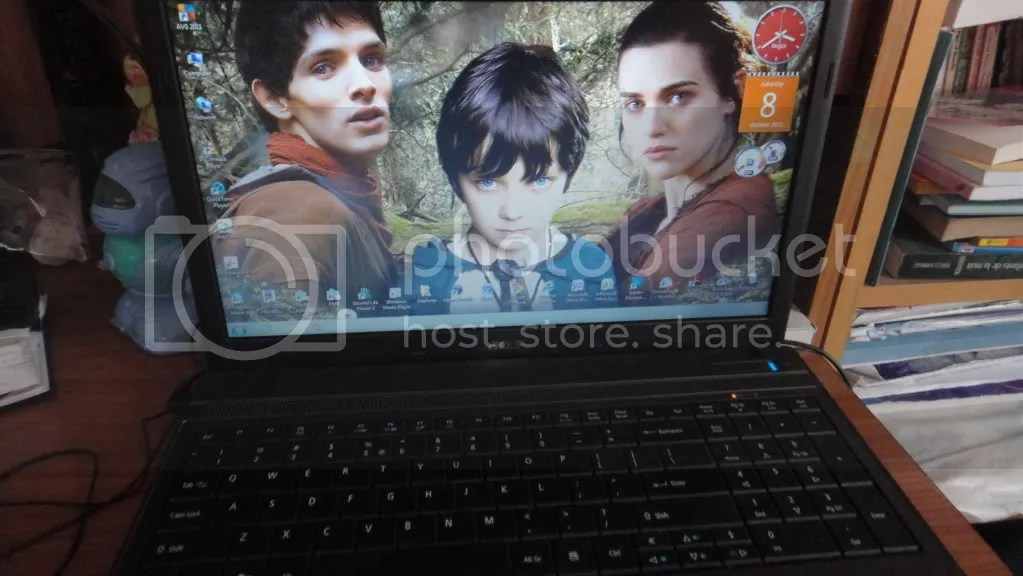 laptop with merlin bbc background
