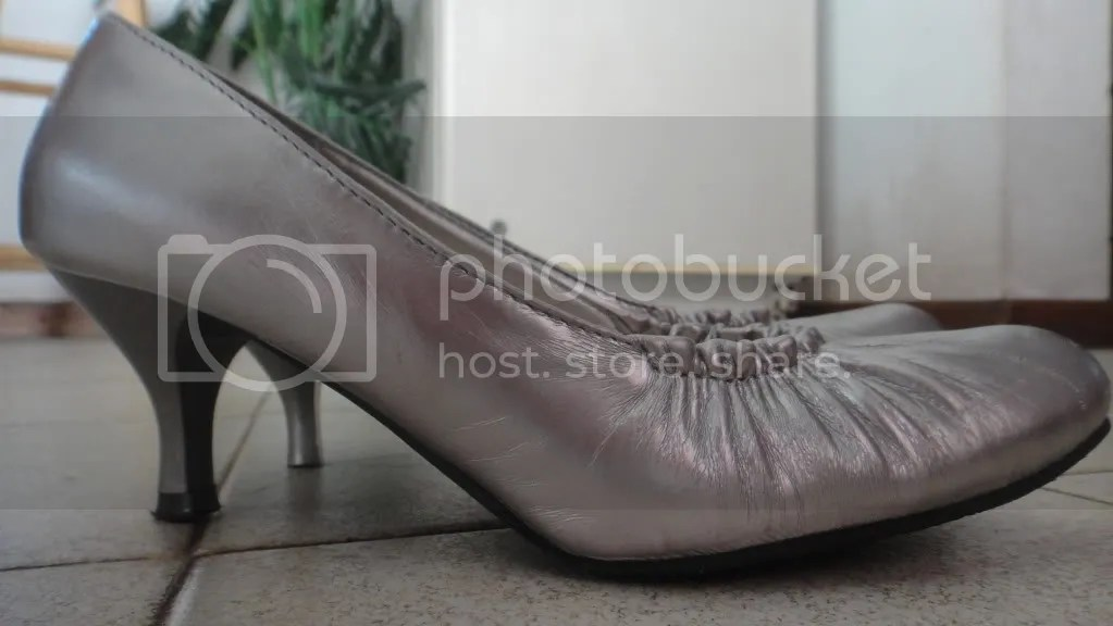 silver high heeled ballerina shoes