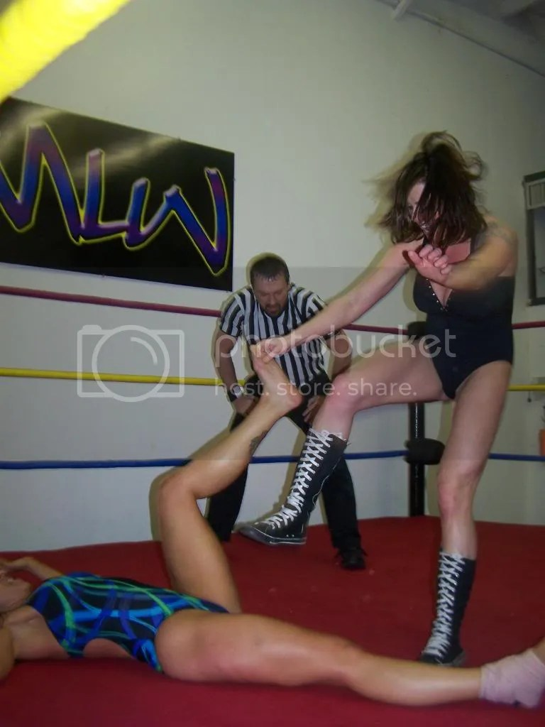 Christie Ricci delivers a hard right boot kick to the back of the left leg of Nikki St. John photo 105_2646.jpg