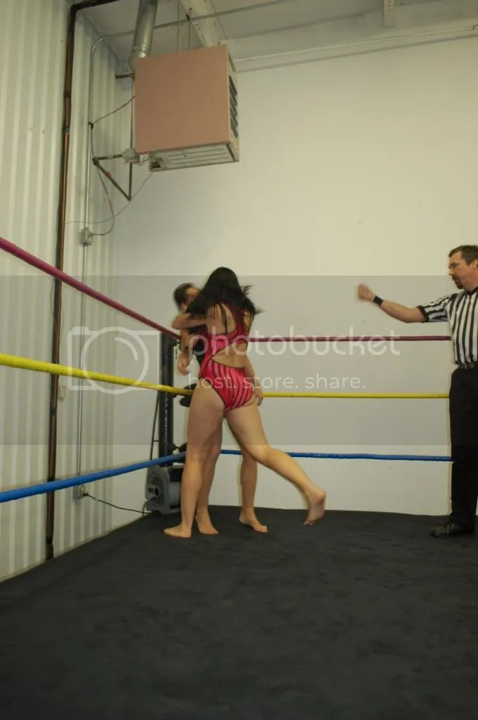 """Smokin' HOTT"" Nikki Lane illegally grabs a hold of the hair of Santana Garrett in the corner photo DSC_0428.jpg"