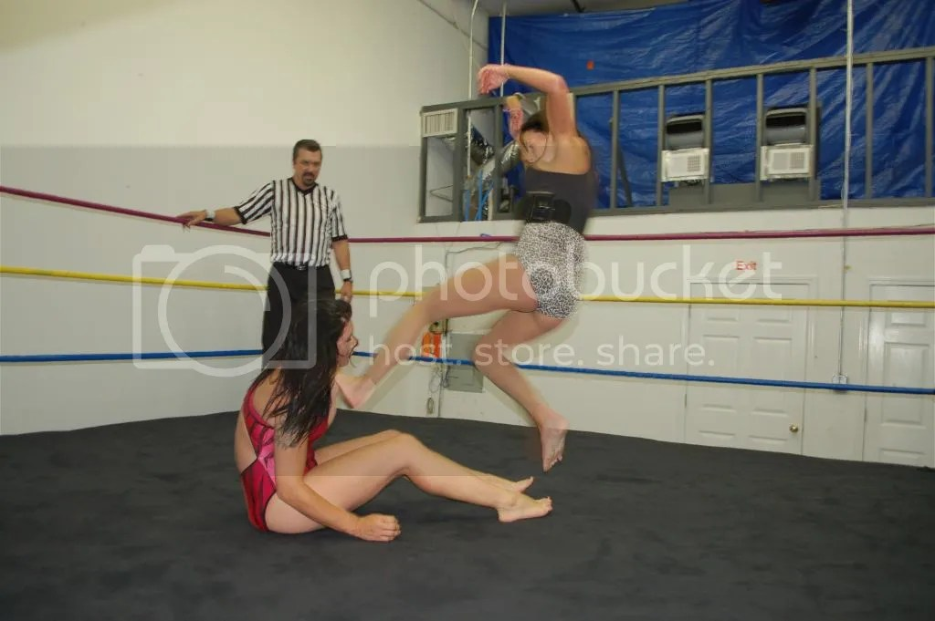 "...and Santana Garrett follows that up with a running flying dropkick to ""Smokin' HOTT"" Nikki Lane photo DSC_0497.jpg"