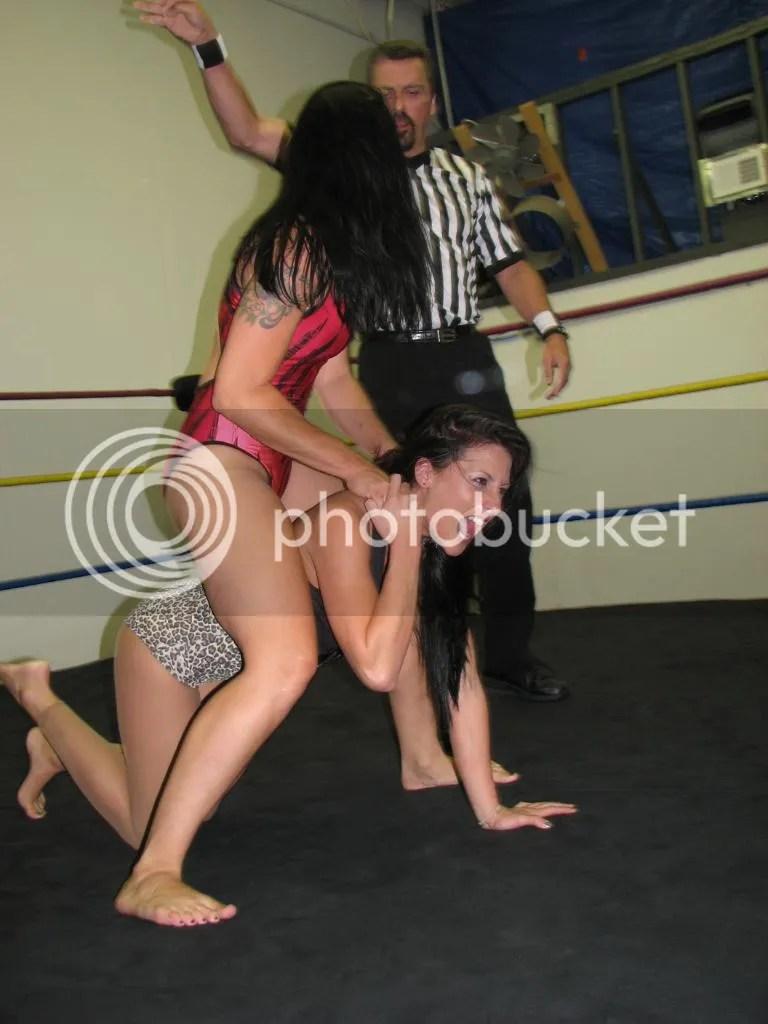 """Smokin' HOTT"" Nikki Lane continues illegally choking the throat of Santana Garrett using Santana Garrett's own hair photo IMG_1808.jpg"