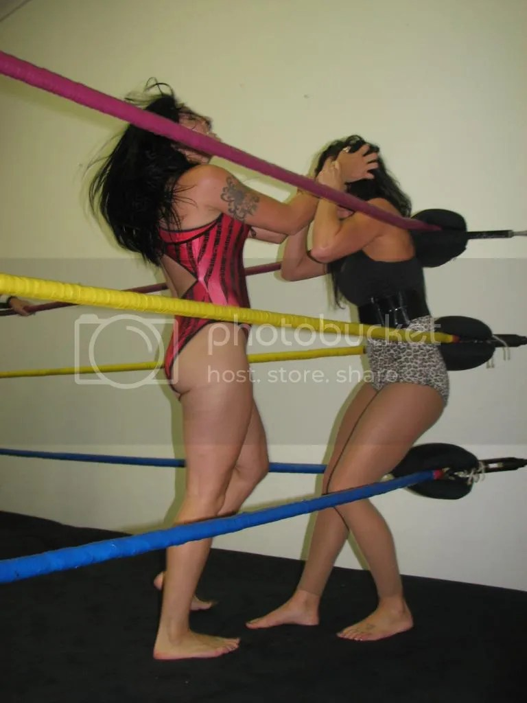 """Smokin' HOTT"" Nikki Lane grabs and pulls on the hair of SAntana Garrett in the corner photo IMG_1827.jpg"