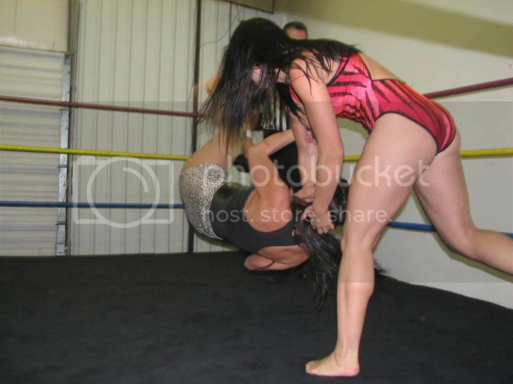 """""""Smokin' HOTT"""" Nikki Lane grabs Santana Garret by her hair and she takes her from the corner and down to the canva with a hair mare photo IMG_1829.jpg"""