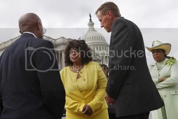 Sanford, Fla. City Manager Norton Bonaparte, Jr., left, speaks to Rep. Corrine Brown, D-Fla., and Sanford, Fla. Mayor Jeff Triplett, and Rep. Frederica Wilson, D-Fla., before a news conference on Capitol Hill in Washington, Tuesday, March 20, 2012, to talk about the shooting of Trayvon Martin. (AP Photo/Jacquelyn Martin)