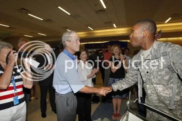 1 hug shy appreciates firm handshake soldier nbspdfw airport 2013