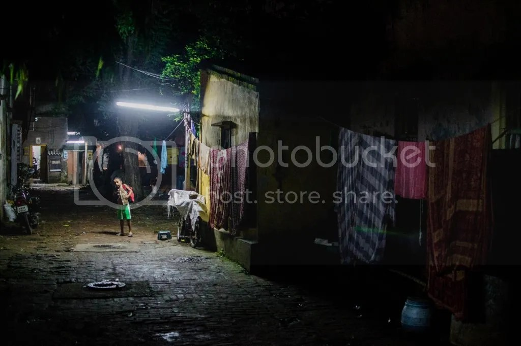 A peek down a nondescript alley met by wary eyes in Kolkata, India