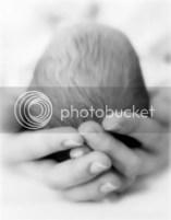 mother holding newborn head