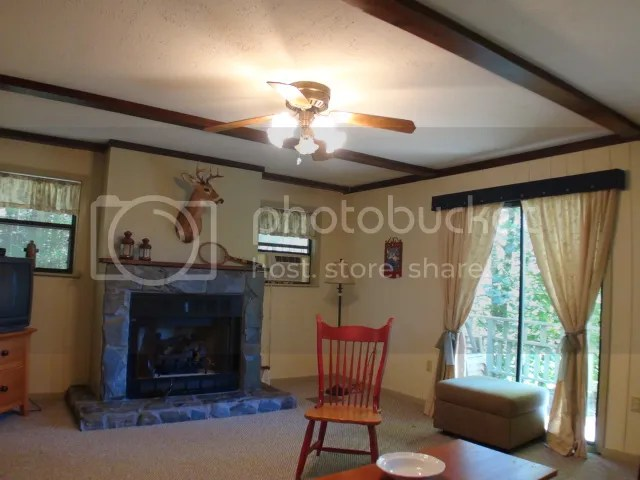 Stone gas log fireplace in the living room, Highlands NC Cabin for Sale, Keller Williams Realty, Smokey Mountain Properties