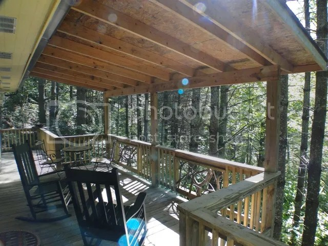 Select a bottle from the wine cooler and enjoy it in front of the stone gas log fireplace or out on the deck!, Mountain Homes for Sale, North Carolina Homes, Macon County Real Estate, Houses in Franklin NC, Cabins in Franklin NC